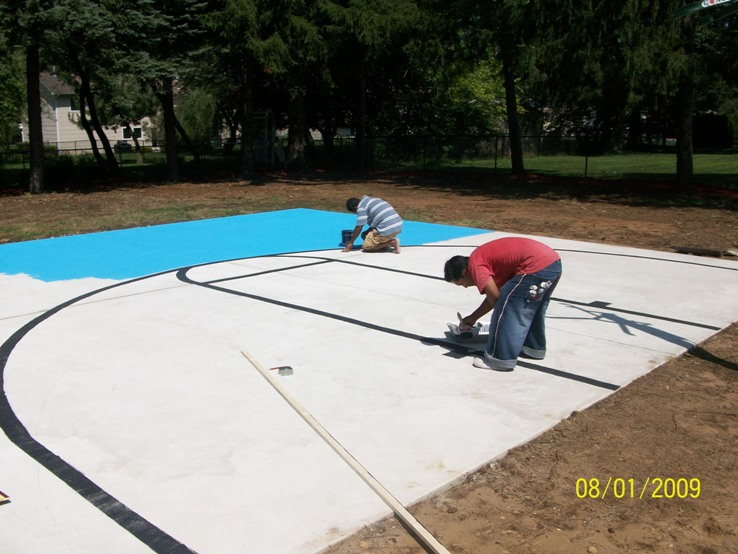 Install basketball court in backyard Basketball court installation cost